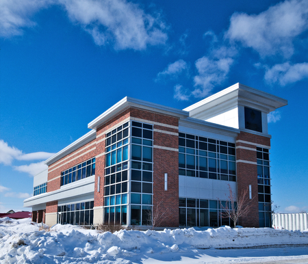 Modern office building. Winters cityscape scene in Minnesota. with blue sky and a few clouds.