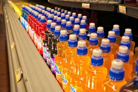 BEMIDJI, MN - 8 FEB 2019: Rows of colorful bottles of beverages stacked on shelves in a local supermarket.
