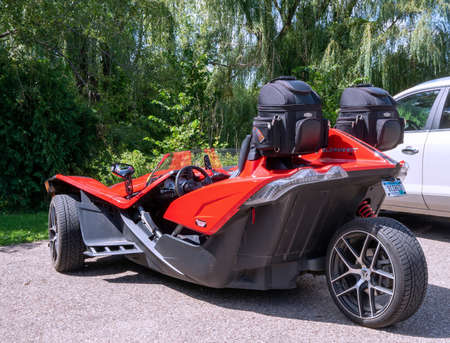 NELSON, WI - 28 AUG 2019: Polaris Slingshot, a three wheeled vehicle with two front wheels and one rear wheel photographed in a parking lot. Editorial