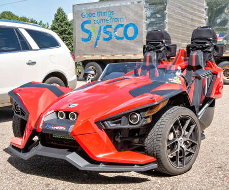 NELSON, WI - 28 AUG 2019: Polaris Slingshot, a three wheeled vehicle with two front wheels and one rear wheel photographed in a parking lot.