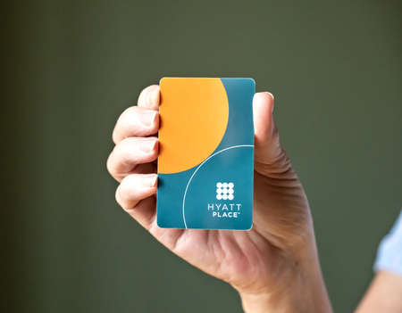 BEMIDJI, MN - 20 JUL 2020: Womans hand holding room security keycard for Hyatt Place Hotels in close-up view.