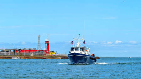 PORT ARANSAS, TX - 29 FEB 2020: The LADY BECKY, a commercial boat boat approaches on the calm blue water on a sunny day.
