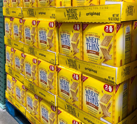 BAXTER, MN - 3 FEB 2021: Store display of boxes of Nabisco Wheat Thins snacks for sale. 100 percent whole grain original snacks with no artificial flavors, colors or cholesterol.