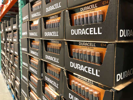 BAXTER, MN - 3 FEB 2021: Display of Duracell C Batteries for sale. Black and gold alkaline battery in pack of 14 on a pallet in a member warehouse store.