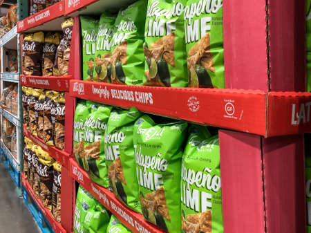BAXTER, MN - 3 FEB 2021: Store display of bags of Late July tortilla chips for sale. Jalopena lime snacks with natural flavor, certified gluten-free, no artificial flavors, colors or preservatives.