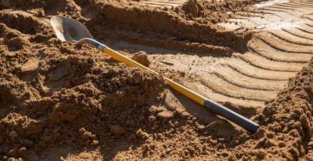 Spade shovel tool with wooden handle for digging into the earth on the dirt