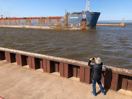 SUPERIOR, WI - 5 OCT 2020: A ship and tourist taking its photo.