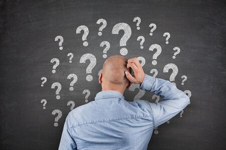Question Marks on Blackboard photo