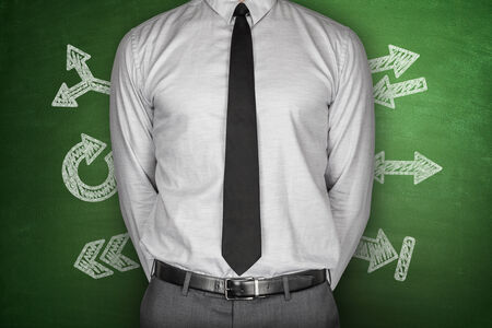Arrows concept with businessman on green Blackboard photo