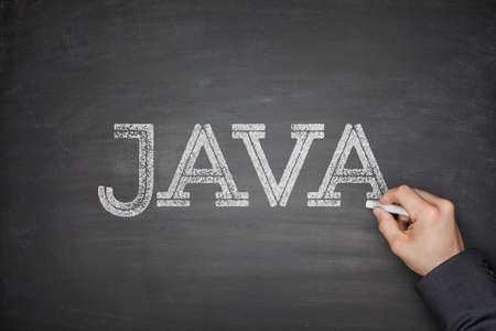 java: Java concept on black blackboard with hand Stock Photo