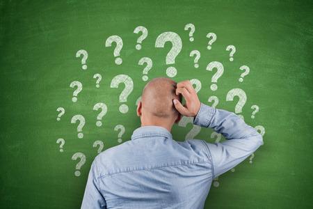 Question Mark on black Blackboard with businessman 写真素材