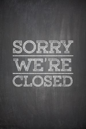 Sorry we're closed on black blackboard Reklamní fotografie