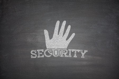 lock block: Security concept on black blackboard with hand