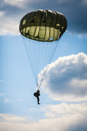 parachute jump: Parachutist in the war  Stock Photo