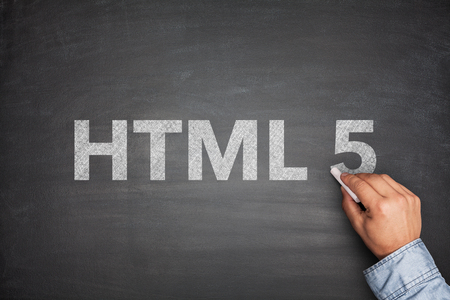 html 5: HTML 5 on black blackboard with male hand Stock Photo