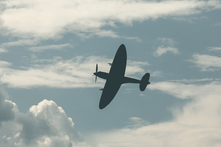 world war ii: Fighter plane on cloudy sky