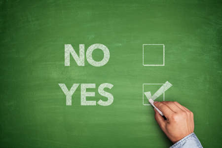 Yes or No, two choices written on blackboard photo