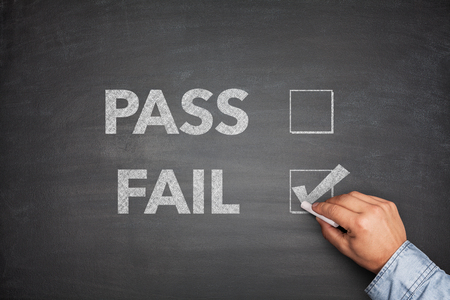disallowed: Tick boxes for Pass or Fail on blackboard Stock Photo