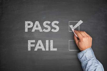 undetermined: Tick boxes for Pass or Fail on blackboard Stock Photo