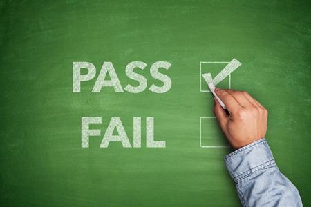 failed politics: Tick boxes for Pass or Fail on blackboard Stock Photo