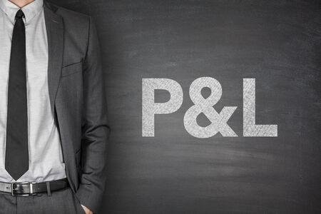 Profit & loss statement on black blackboard with businessman photo