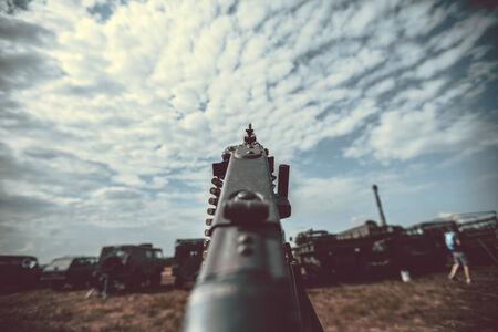 Old vintage machine gun standing on tripod