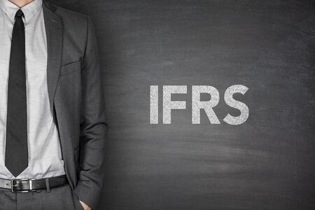 International financial reporting standards on black blackboard photo