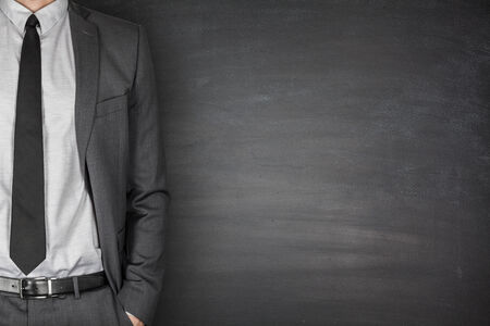 file clerk: Businessman with suit and tie front of Blackboard