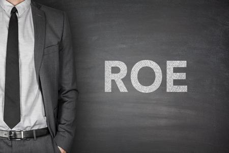 Return on equity on black blackboard with businessman photo