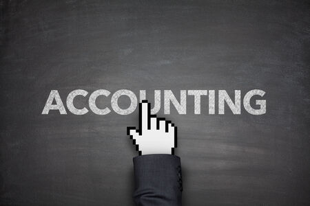 Accounting word on black blackboard with hand photo