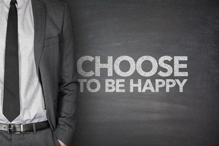 Choose to be happy on blackboard with businessman photo