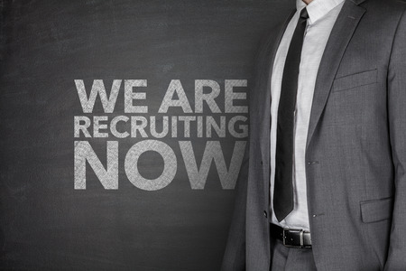 We are recruiting now on blackboard with businessman photo