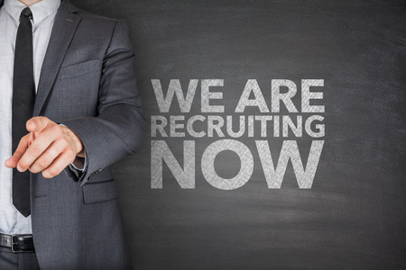 We are recruiting now on blackboard with businessman Archivio Fotografico
