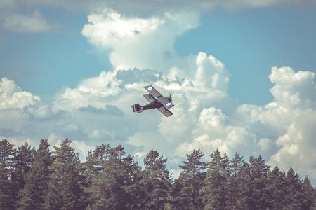 World War II airplane on cloudy sky Stock Photo