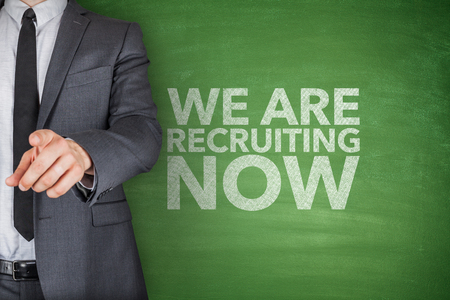We are recruiting now on blackboard with businessman Stock Photo