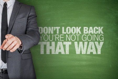Dont look back.Youre not going that way on blackboard photo