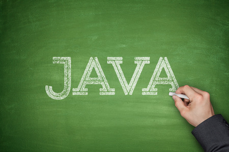 java: Java concept on greem blackboard with hand