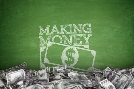 making money: Making money on blackboard with pile of dollar bills