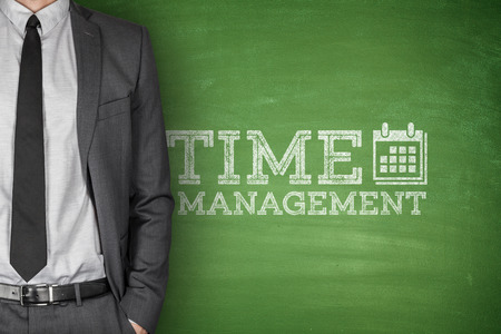 scheduling system: Time management on green blackboard with businessman Stock Photo