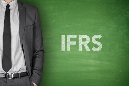 standards: International financial reporting standards on green blackboard Stock Photo