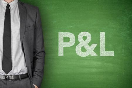Profit & loss statement on green blackboard with businessman Фото со стока