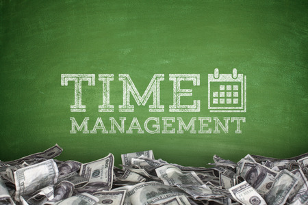 personal data assistant: Time management on blackboard with pile of dollars Stock Photo