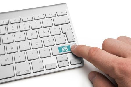 Job text on return key on metallic keyboard photo