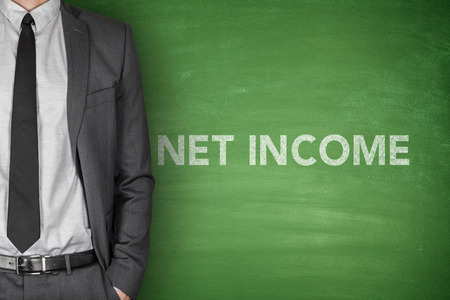 net income: Net income text on green blackboard with businessman