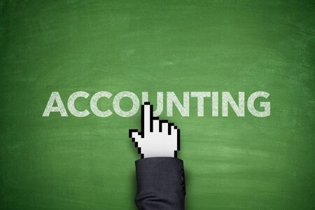 Accounting word on green blackboard with hand photo