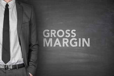 corporate finance: Gross margin on black blackboard with businessman