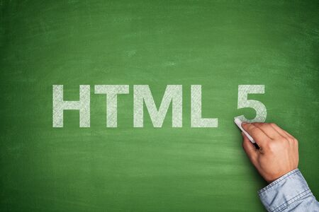 html 5: HTML 5 on green blackboard with male hand