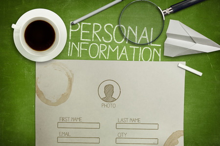Personal information form concept on green full frame blackboard with coffee cup, paper and magnifying glass Imagens