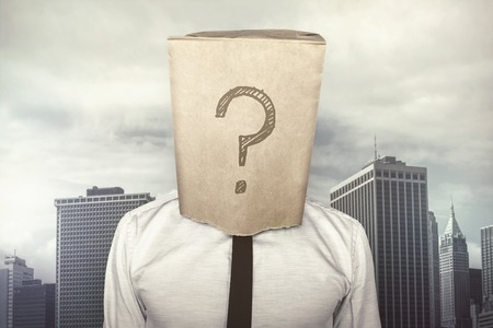 Businessman with a paper bag on head with question mark