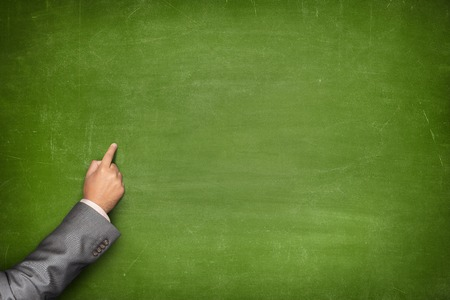 green in hand: Blank green blackboard with businessman hand pointing